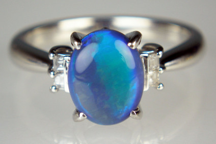 Black opal & diamond ring in platinum - 1.6ct black opal in bright blue and purple with turquoise cats eye effect set with 0.08ct diamonds in platinum ring