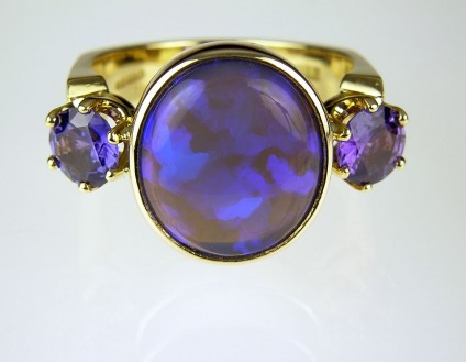 Black Opal & Sapphire Ring - Black opal and purple sapphire ring in 18ct yellow gold.