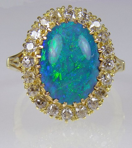 Antique Opal & Diamond Ring - Victorian ring of 4.77ct black opal and old cut diamonds set in 18 carat yellow gold. 20 x 16mm. Independent valuation for insurance is included with this piece.