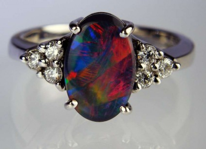 Black opal & diamond ring - 11 x 7mm solid black opal set with 0.24ct G colour VS clarity diamonds in 9ct white gold