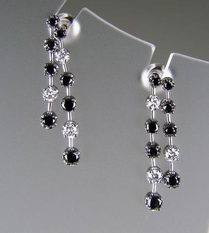 Black & White Diamond Earrings in 18ct white gold - Black & white diamond earrings in 18ct white gold set with 0.67ct black diamonds & 0.29ct white diamonds.