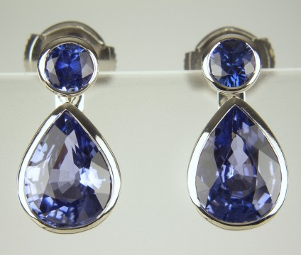 Sapphire Earrings with detachable drops - Round brilliant cut blue sapphires totalling 0.49ct with detachable pear cut sapphire drops of 3.60ct, all bezel set in 18ct white gold.