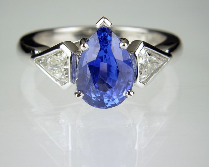 Sapphire & Diamond Ring in Platinum - Pear cut blue sapphire ring with matched pair of kite cut diamonds, ring set in platinum.