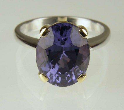 Blue spinel ring - 5.97ct oval blue/lilac blue colour change spinel, with independent report confirming wholly untreated, set in 18ct yellow gold claws on 18ct white gold shank