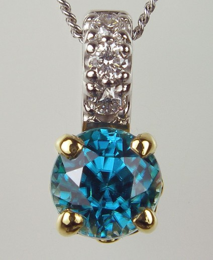 Blue Zircon & Diamond Pendant - Blue Zircon Pendant Pendant of 1.19ct blue zircon (this is a natural stone, NOT to be confused with cubic zirconia!) and 0.06ct diamond in 18 carat white & yellow gold. 5 x 11mm.
