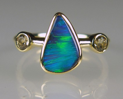 Boulder opal & precious topaz ring - Vivid blue/green boulder opal 1.90ct from Queensland, Australia, set with 2 x 3.5mm round precious (golden) topaz in 18ct yellow gold