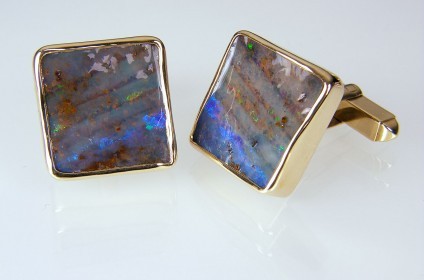 Boulder Opal Cufflinks  - Boulder opal cufflinks in 9ct yellow gold. 17mm square.