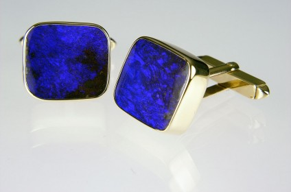 Boulder Opal Cufflinks  - Boulder opal cufflinks in 9ct yellow gold, set with 23.42ct Queensland boulder opal pair.
