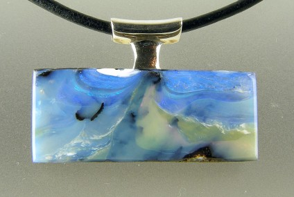 Boulder opal pendant in silver  - Boulder opal pendant in silver on leather cable. 33 x 22mm.