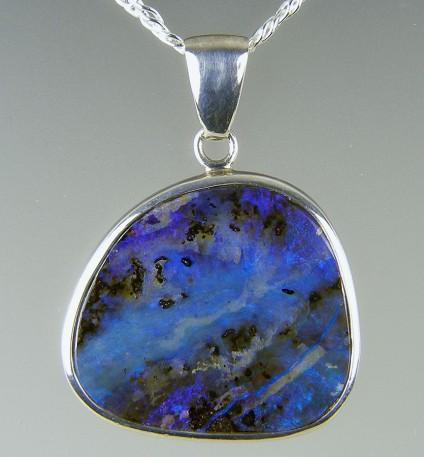 Boulder opal pendant in silver - Boulder opal pendant in silver on silver chain. 30 x 40mm.