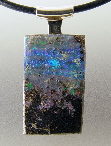 Boulder opal pendant in silver - Boulder opal pendant in silver on leather cable. 37 x 17mm.
