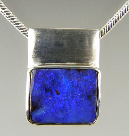 Boulder opal pendant in silver - Boulder opal pendant in silver on heavy silver chain. 25 x 17mm.