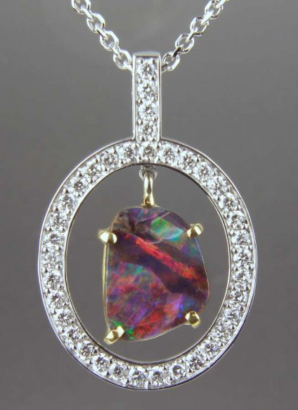 Boulder Opal & Diamond Pendant - 1.27ct boulder opal, vividly coloured, and mounted in 18ct yellow gold claws, suspended within a diamond set oval frame in 18ct white gold, on an 18ct white gold frame.