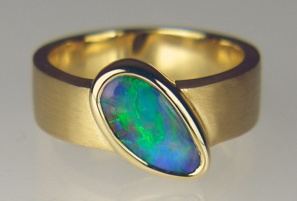 Boulder opal ring in 18ct brushed gold - Stunning boulder opal set in brushed 18ct yellow gold. Ring size Q (8 1/4). Due to the difficulties of resetting opals in rubover settings, this ring cannot be resized down.