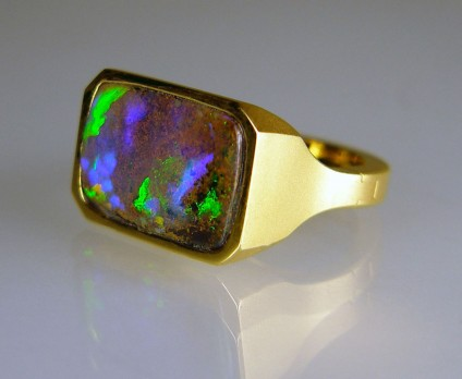 Boulder opal ring in 14ct yellow gold opening shank - 8.33ct vibrant purple green boulder opal rubover set in satinised finish 14ct yellow gold mount.  The mount incorporates the special SUPERFIT opening shank for a customer with slim fingers and larger knuckles.