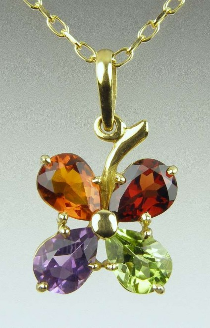 Flower Pendant in Vivid Coloured Gems - Pear cut Brazilian gemstones totalling 1ct in peridot, garnet, citrine & amethyst, set in 18ct yellow gold on a matching chain.