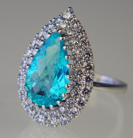 Paraiba tourmaline & diamond ring - Pear cut tourmaline from Paraiba, Brazil, weighing 3.78ct set with 1.57ct diamonds in E colour VS clarity and mounted in an 18ct white gold setting.