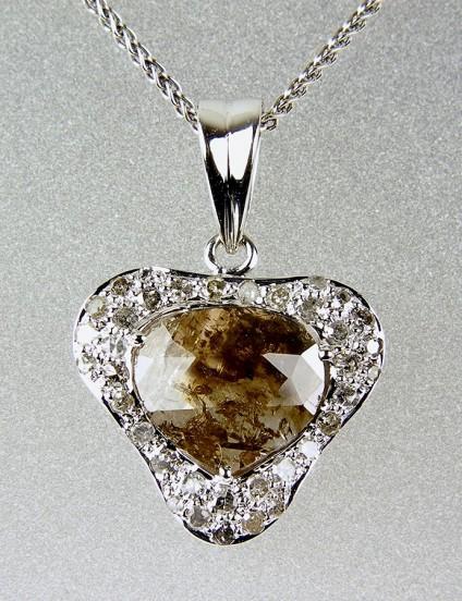 Brown diamond pendant in white gold - Brown diamond slice pendant - Pendant in 18ct white gold set with a faceted brown diamond slice of 1.67ct and 0.28ct round diamonds.