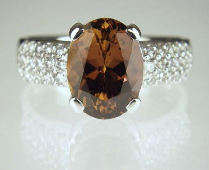 Brown sapphire & diamond ring - 4.56ct oval brown sapphire set with 0.47ct round brilliant cut diamonds in 18ct white gold