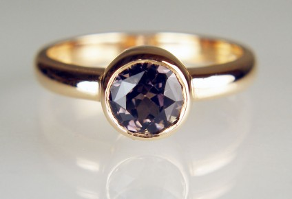 Brownish grey sapphire ring in 18ct rose gold - 1.34ct round brownish greyish sapphire in 18ct rose gold rubover ring. The sapphire is 6.1mm in diameter.