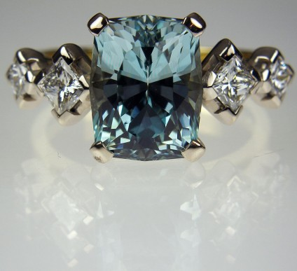 Aquamarine & Diamond Ring in 18ct Gold - 4 carat antique cut African aquamarine (unheated), flanked by two matching pairs of princess cut white diamonds totalling 0.6carats in weight.