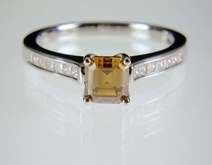Coloured & white diamond ring in platinum - Cinnamon diamond ring in platinum.  Natural golden brown diamond, emerald cut, 5mm square set in platinum with princess cut diamond shoulders totalling 0.3ct.