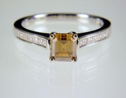 Coloured & white diamond ring in platinum - Cinnamon diamond ring in platinum.  Natural golden brown diamond, emerald cut, 5mm square set in platinum with princess cut diamond shoulders totalling 0.3ct.