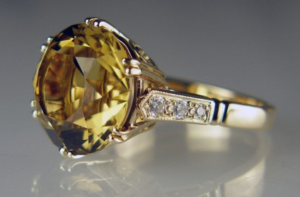 Citrine & diamond ring in yellow gold - 9.17ct round fancy cut citrine (cut by Ian Hardy Robertson Shand DFC DSO) set with diamonds in 9ct yellow gold