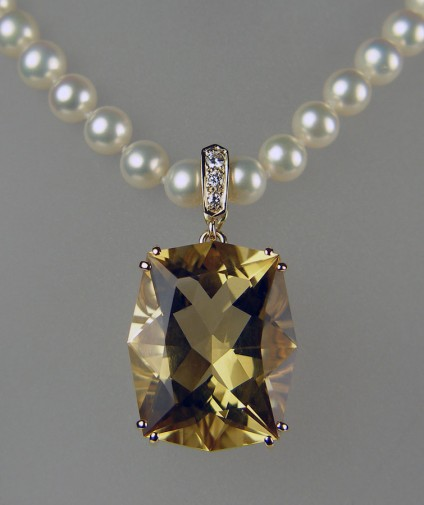 Citrine, diamond and pearl necklace in yellow gold - 27.53ct fancy cut citrine, set with diamonds in 9ct yellow gold as a pearl enhancer pendant suspended from delicate cultured pearl necklace.