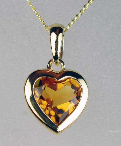 """Citrine heart pendant in 9ct yellow gold - Pretty heart cut citrine eighing 0.98ct, rubover set in 9ct yellow gold and suspended from an 18"""" 9ct gold chain"""