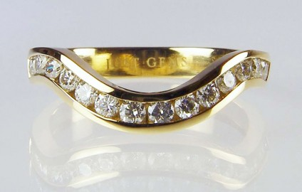 Curved Eternity Ring - 14 round brilliant cut 0.56ct diamonds set in a curved eternity ring in yellow gold