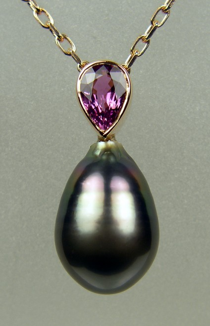 "Purple sapphire & Tahitian pearl pendant in rose gold - 0.92ct pear cut  purple sapphire set with a dark Tahitian drop shaped pearl with purple overtones in 18ct rose gold and suspended from an 18ct rose gold chain 16-18"" adjustable.  The pendant is 24mm long."
