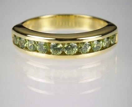 Demantoid garnet ring in gold - 1.01ct Namibian demantoid garnet ring channel set in 18ct yellow gold.