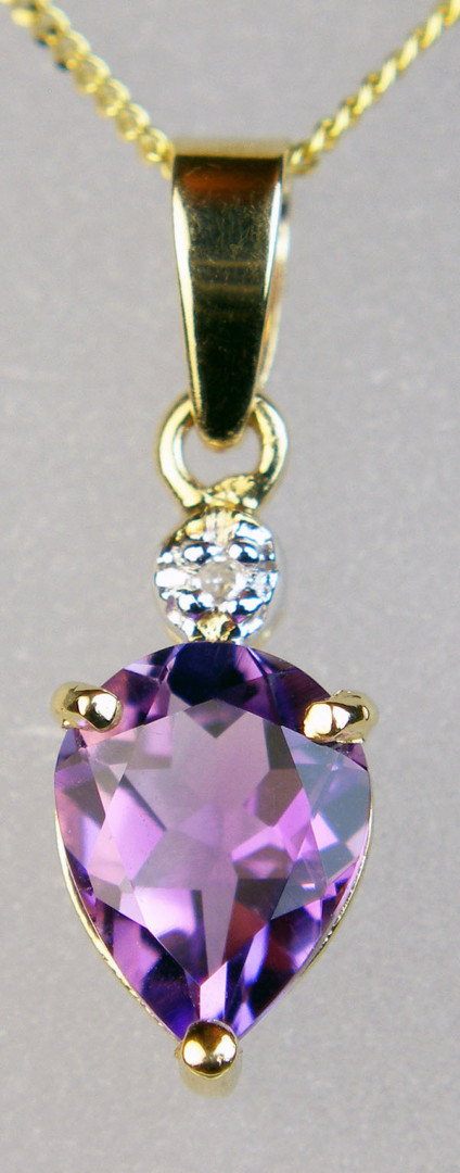 """Amethyst & diamond pendant - Delicate pendant in 9ct yellow gold set with a pear cut amethyst and dainty 1.1mm diamond, on an 18"""" chain. Pendant in 18mm long and 6mm wide."""