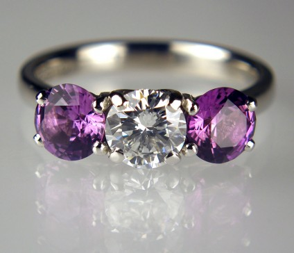 Purple sapphire & diamond ring - 0.81ct round brilliant cut diamond in F colour SI2 clarity, excellent cut quality, set with a matched pair of 1.74ct purple sapphires, mounted in platinum