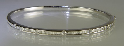 Baguette and round cut diamond bangle - 18ct white gold bangle set with 0.68ct baguette cut and 0.23ct round brilliant cut diamonds in G colour VS clarity.
