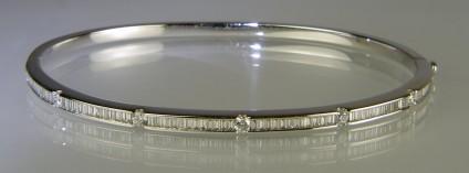 Baguette and round cut diamond bangle - 18ct white gold bangle set with 0.68ct baguette cut and 0.23ct round brilliant cut diamonds in G colour VS clarity.