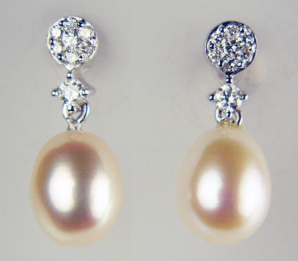 Delicate pearl drop and diamond earrings in 9ct white gold - 18pt of diamonds mounted with delicate pinkish-white cultured pearls 9 x 7mm make a beautiful combination set in 9ct white gold in these beautiful earrings measuring a total length of 18mm