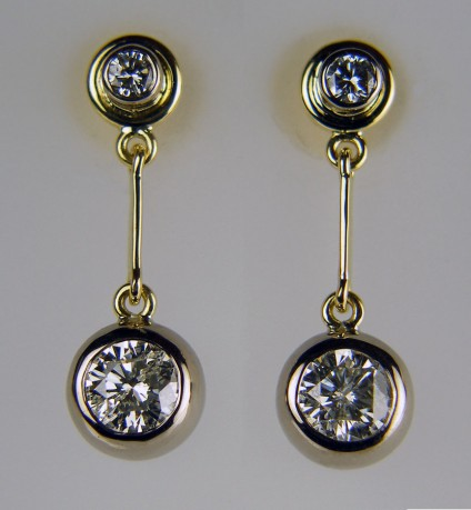 Diamond drop earrings - Diamond earrings made using the customer's two pairs of claw set diamond earstuds, totally remodelled into a stunning pair of diamond drop earrings using a combination of rubover settings in 18ct white & yellow gold