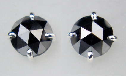 0.95ct rose cut black diamond earstuds set in 18ct white gold - Pair of domed rose cut black diamonds claw set in 18ct white gold. Earstuds are 4.7mm in diameter. Total diamond weight is 0.95ct
