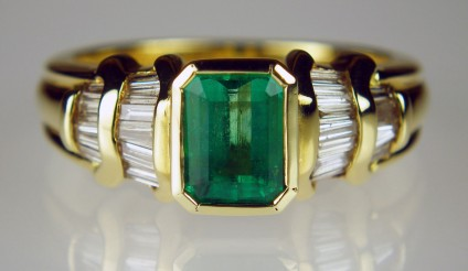 Emerald and diamond baguette ring - 1.09ct emerald cut Colombian emerald set with 0.49ct of baguette cut diamonds in 14ct yellow gold