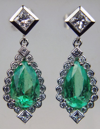 Emerald & diamond earrings - Emerald & diamond earrings in platinum set with a 4.22ct pair of pear cut Colombian emeralds and 1.35ct diamonds in F/VS quality. Largest diamond are a pair of 0.33ct princess cuts. Total earring length 29mm.
