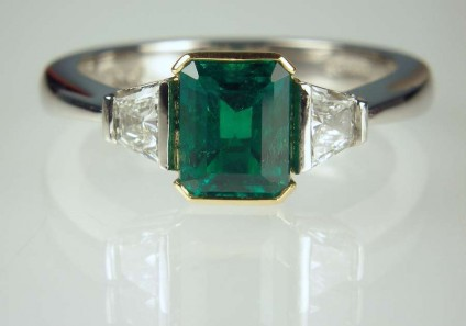 Emerald & diamond ring - 1.03ct emerald (from Muzo, Colombia), set with 0.31ct pair of taper cut diamonds F colour VVS clarity in platinum and 22ct yellow gold