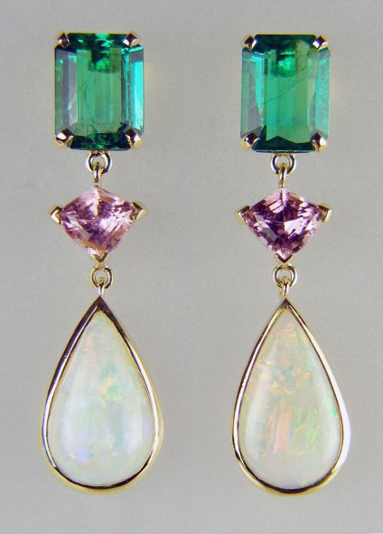 Emerald, tourmaline & opal earrings in yellow gold - Stunning pair of drop earrings set with a 3.17ct emerald cut pair of superb quality Colombian emeralds, a 1.17ct shield cut pair of pink tourmalines and 3.27ct pair of cabochon pear opals from Coober Pedy, all mounted in 18ct yellow gold
