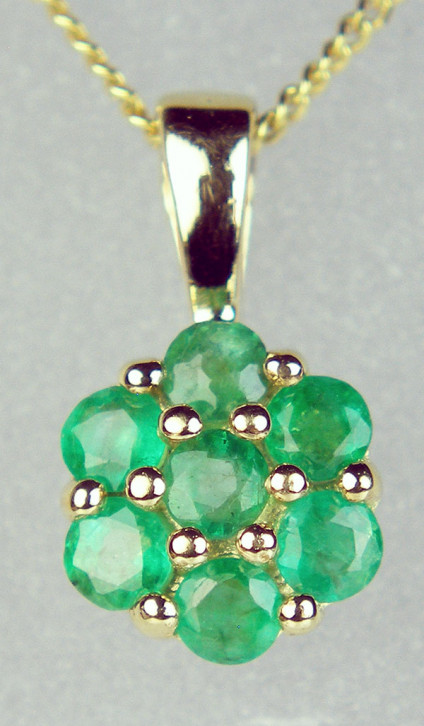 Emerald cluster pendant in 9ct yellow gold - seven stone emerald cluster pendant in 9ct yellow gold