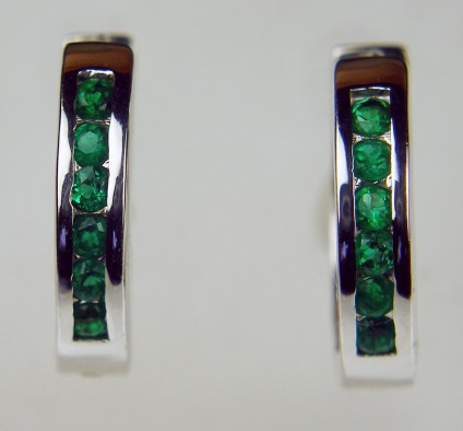 Emerald hoop earrings in 18ct white gold - Bright and highly wearable! Colombian emerald rounds set in 18ct white gold hoop earrings. Earrings measure 18mm in diameter.