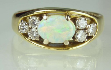 Opal & diamond ring - Estate piece.  Set with 0.5ct oval white opal and 0.24ct diamonds in 18ct yellow gold.