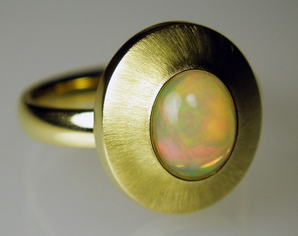 Ethiopian opal ring in 18ct gold - 1.34ct Ethiopian opal cabochon mounted in 18ct yellow gold
