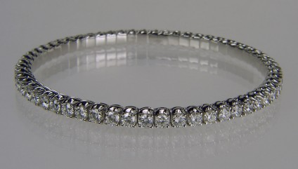 Expanding range full set diamond bangle - Picchiotti designed and manufactured expanding full set bangle with 5.61ct of G colour VS clarity round brilliant cut diamonds, each diamond 3mm in diameter. The bangle is made with the diamonds mounted in jointed links connected to a superbly crafted highly durable titanium spring. The bangle can expand up to 4cm to allow comfortable and secure wear.  It is flexible and comfortable to wear, resistant to knocks and pressure, making it a secure and extremely durable alternative to the traditional diamond tennis bracelet or rigid bangle.  18ct white gold.   Bangle is manufactured to order only and can be made with any combination of gemstones to the customer's requirements.