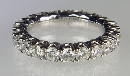 Expanding range diamond eternity ting - Picchiotti designed and manufactured expanding full set eternity ring with 2.33ct of G colour VS clarity round brilliant cut diamonds, each diamond 3mm in diameter. The ring is made with the diamonds mounted in jointed links connected to a superbly crafted highly durable titanium spring. The ring can expand up to 5 ring sizes to allow comfortable and secure wear even on fingers with large knuckles or where the wearer routinely experiences changes in finger size. 18ct white gold.   Ring is manufactured to order only and can be made with any combination of gemstones to the customer's requirements.